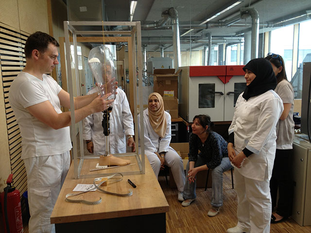 HS lecturer demonstrates alignment of Lower Extremitiy Prosthetics